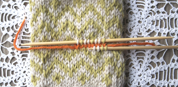 Picking up stitches below waste yarn on afterthought thumb